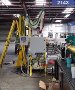 LP120 packaging machine being installed at a company for manufacturing 10 foot downspouts